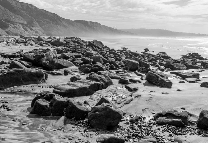 Black And White Beach Meditation Travel Beach Beauty In Nature Black And White Budget Traveller Day Horizon Over Water Meditate Nature No People Outdoors Pebble Beach Rock - Object Sand Scenics Sea Shore Sky Tranquil Scene Tranquility Travel Blog Vacation Water
