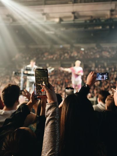 Women filming with smart phones in music concert