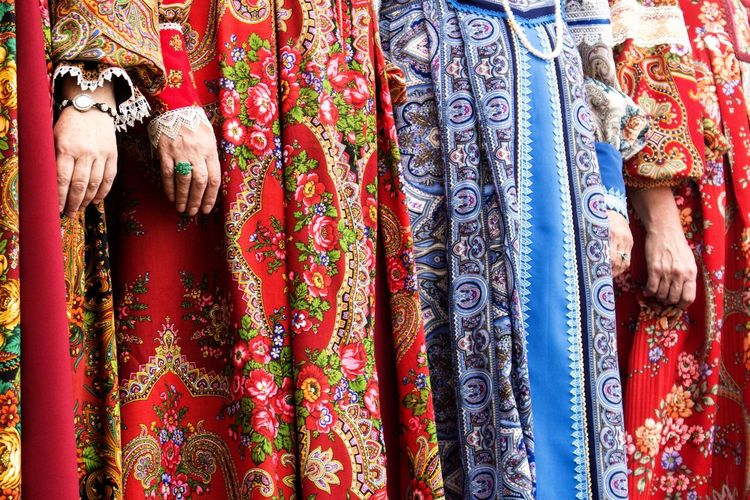 Midsection of women wearing traditional clothing