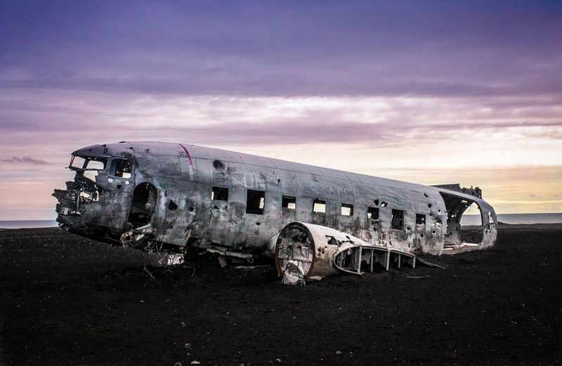 Abandoned airplane with sky in background