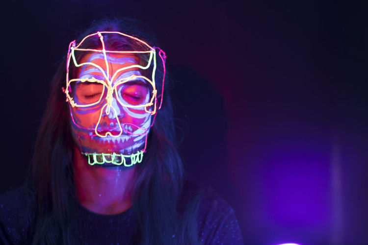 Close-Up Of Woman With Light Painting In Dark