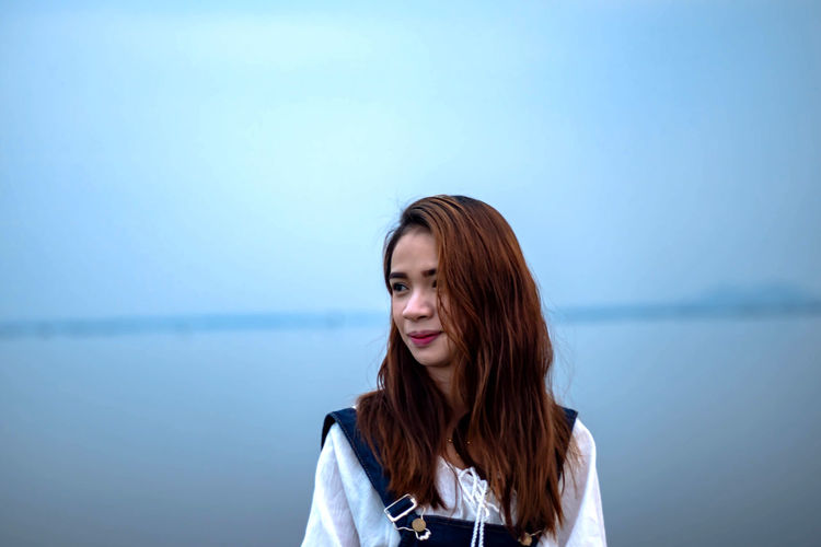 Lovely Women On Vacation Asian Women Dungarees Area Waterfront Portrait Long Hair Young Adult One Person Hairstyle Beauty Hair Beautiful Woman Women Headshot Young Women Standing Adult Brown Hair Water Looking At Camera Copy Space Front View Looking Teenager