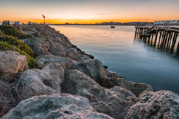 Sunset in Bather's Beach, Fremantle WA Australia Sunset Sky Water Rock Solid Rock - Object Sea Scenics - Nature Beauty In Nature Nature Architecture Built Structure Tranquility Orange Color Cloud - Sky No People Tranquil Scene Building Exterior Outdoors Groyne