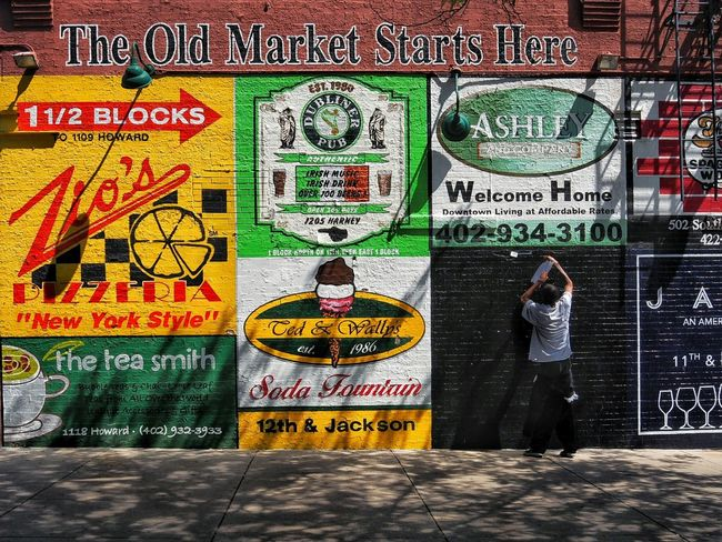 Omaha old market. Text Graffiti Multi Colored Day Gambling Outdoors No People Omaha, Nebraska American Dream America City Moments Streetphotography Streetphoto_color Architecture Text Brick Wall Madmen-kollektiv.org Building Exterior Travelling EyeEm Selects Summer Adult Business Finance And Industry Travel Destinations
