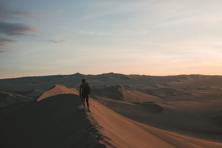 Rear view of man at desert