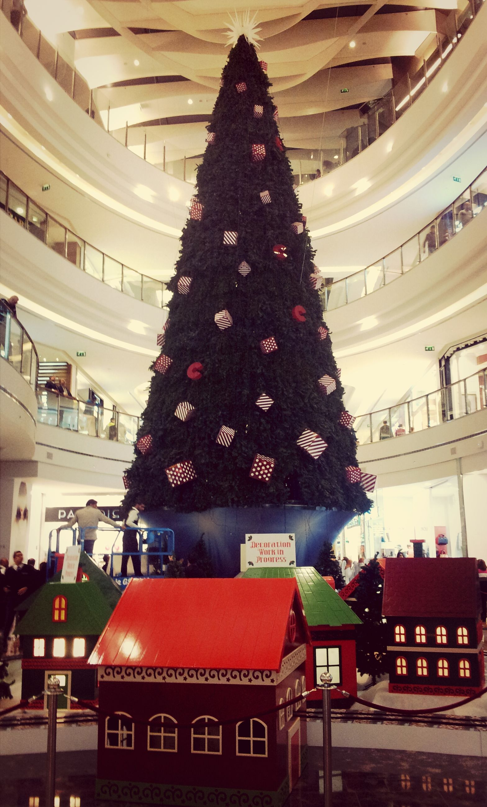architecture, building exterior, built structure, freshness, decoration, celebration, hanging, christmas, christmas tree, flower, tradition, red, illuminated, high angle view, city, incidental people, christmas decoration, roof, outdoors