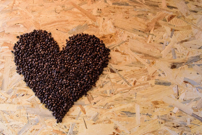 Coffee beans in a shape of heart Coffee Coffee Time Looking Down Shape Textured  Background Brown Close-up Coffee Beans Coffee Lover Food Food And Drink Full Frame Heart Shape Heart Shaped  High Angle View Love No People Patters Roasted Coffee Beans Shape Of Heart Table Textured  Wood - Material