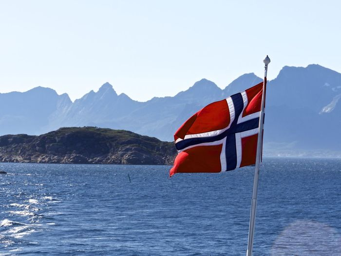 Flag Of Norway Beauty In Nature Clear Sky Day Flag Flag Pole Lake Mountain Mountain Range Nature No People Outdoors Patriotism Red Scenics Sky Tranquil Scene Tranquility Water