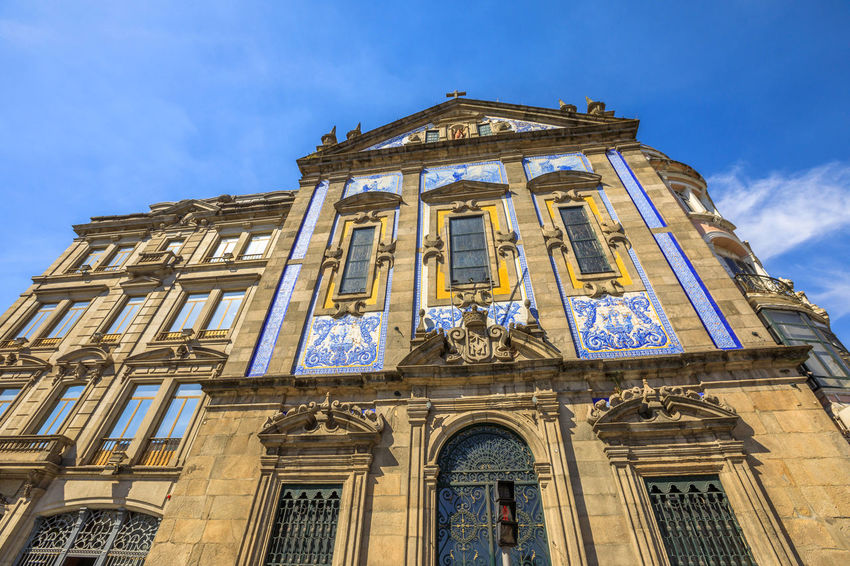 Azulejo tiles covering the facade of Saint Anthony's Church Congregados in Almeida Garrett square, Porto historic center, Portugal, Europe. Portugal Porto Tourism City Aerial View Cloudscape Cityscape Landscape Panorama Europe People Church Church Architecture Architecture Town Porto Portugal 🇵🇹 Monment Oporto City Oporto Downtown Oporto Streets Low Angle View Building Exterior Built Structure The Past History Sky Building Travel Destinations Window Façade Religion Belief No People Spirituality Place Of Worship Travel Arch Architectural Column Outdoors Ornate Clock Government
