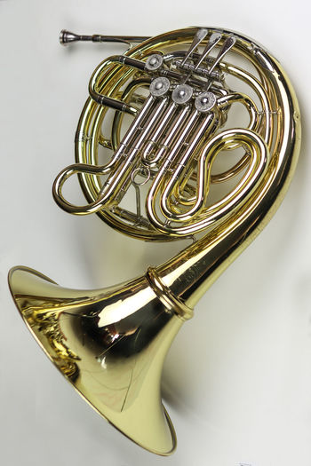 Music Instrument French horn Musical Instrument White Background Metal Studio Shot Music Brass Instrument  Brass Arts Culture And Entertainment Gold Colored Indoors  Still Life Single Object No People Trumpet Cut Out Wind Instrument Close-up Musical Equipment Gold Shiny Silver Colored