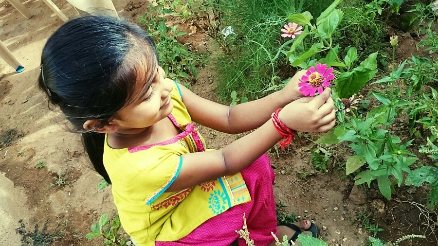 Untold Stories Learn & Shoot: Layering Protecting Where We Play Mobiography Urban LifestyleFlowers,Plants & Garden Flowers Hello World Outdoor Check This Out ... My little sister in mini garden ... Trying to pose with the flower !!! Mobile Photography AmmuzClikzzz