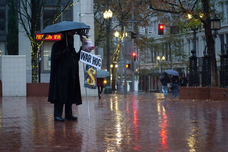 """""""Political Piggy"""" One Person Night Illuminated City Street City Outdoors People Standing Sign Photooftheday On The Move Text Building Exterior Protest Protesters Bestoftheday Best EyeEm Shot Followme Likeforlike"""