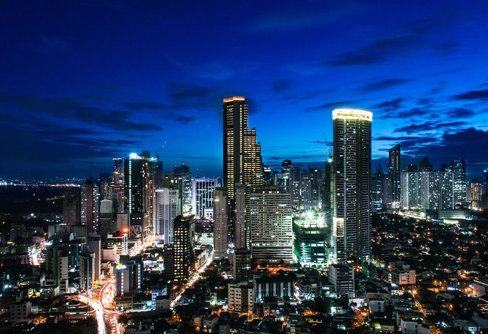 Blue Hour. Skyscraper Illuminated Architecture Night Building Exterior Dusk Business Finance And Industry Development Downtown District High Angle View Urban Skyline Modern Travel Destinations Financial District  City Life Outdoors Cityscape City Blue Tivoli Garden Manila Phillipines Manila Mandaluyong City Sky City Life EyeEmNewHere