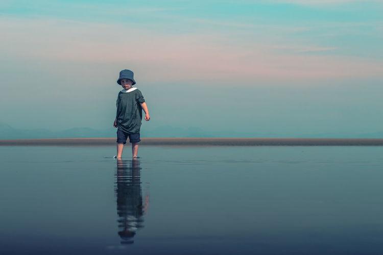 Child walking through water