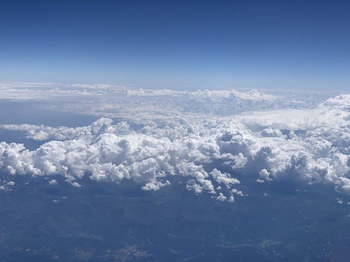 Aerial view of cloudscape against blue sky