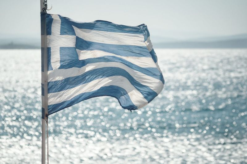Close-up of flag against sea