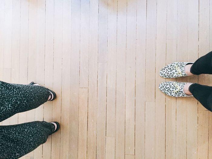 Low Section Of Women Walking On Hardwood Floor