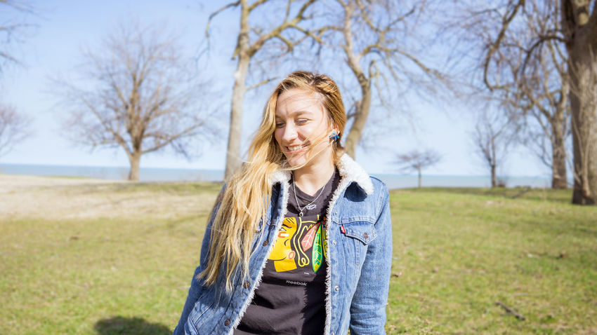 The Portraitist - 2017 EyeEm Awards Portrait One Person Blond Hair Happiness Outdoors Beauty Smiling Adult Bare Tree Cheerful Only Women Looking Away People Posing Model Pretty Girl Spring Jean Jacket Fashion Hairstyle