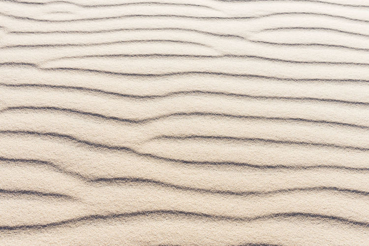 traces wave on sand Beach Beauty In Nature Brown Curves Day Desert Full Frame Natural Pattern Nature No People Sand Sun Traces Tranquility Water