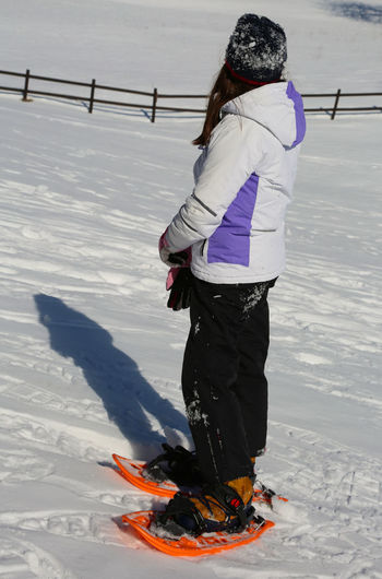 girl with sportwear and orange snowshoes in winter Children Females Snowshoe Winter Child Cold Girl Little Girl Outdoors Snow Snowshoe Trip Snowshoeing Snowshoes Snowshoes Girl Sport Sportwear Sportwears
