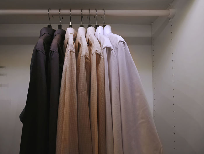 Collection of Formal Shirts for Businessmen Businessman Button Down Shirt Choice Close-up Closet Clothes Rack Clothing Coathanger Fashion Formalwear Furniture Garment Hanging In A Row Indoors  Menswear No People Order Rack Retail  Side By Side Still Life Variation