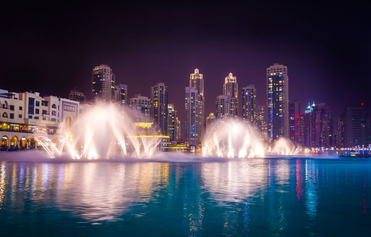Marina Dubai Architecture Building Exterior Night City Water Built Structure Building Office Building Exterior Illuminated Cityscape Skyscraper Urban Skyline Motion Fountain City Life Long Exposure Landscape Nature No People Modern Outdoors Spraying Flowing Water Luxury