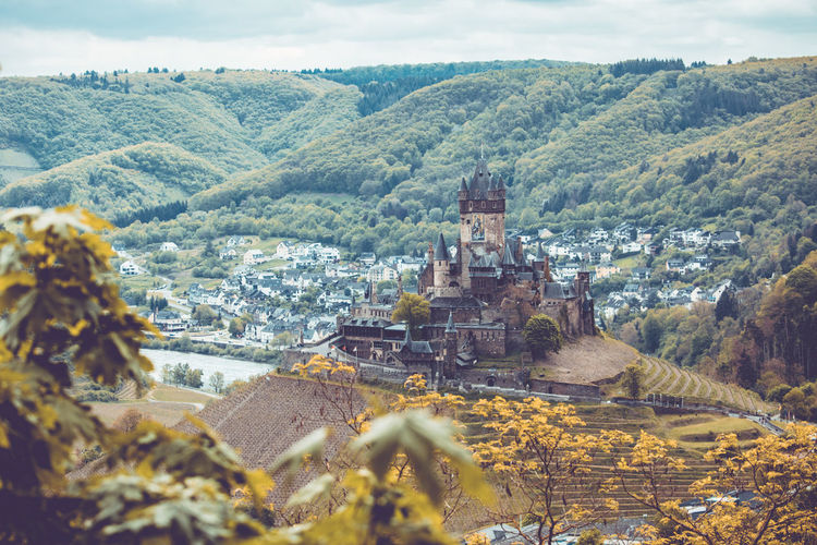 Areal view of Castle Cochem in the mosel valley, Cochem, Rheinland-Pfalz, May 2019. Germany Mosel Architecture Mountain Built Structure Tree Building Exterior Plant Sky Nature Environment Landscape Building No People Outdoors Cochem Castle Cochem Cochem Castle History The Past Travel Destinations Day Travel Ancient Ancient Civilization