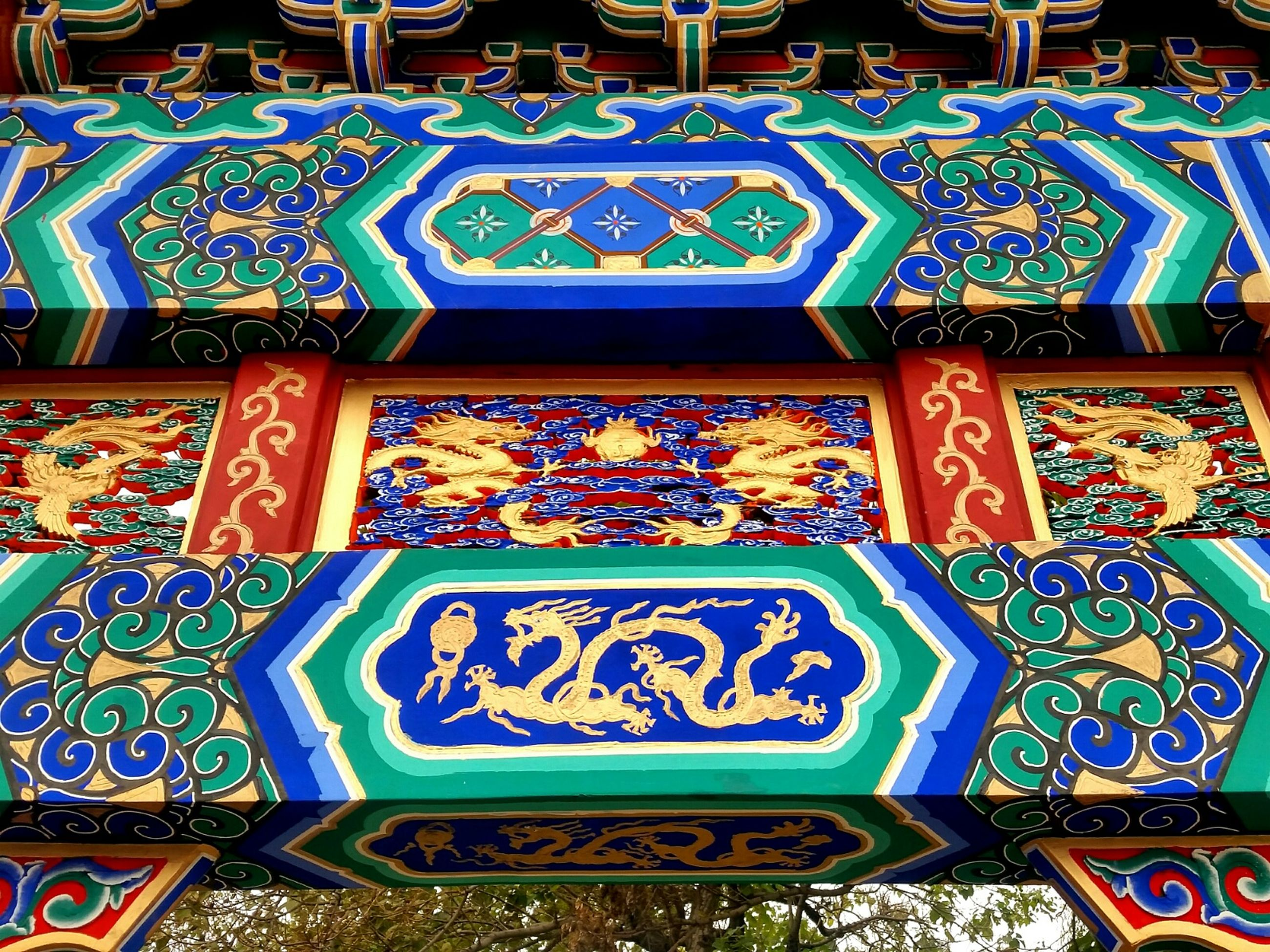 multi colored, art and craft, art, creativity, design, ornate, religion, place of worship, decoration, spirituality, indoors, pattern, architecture, built structure, floral pattern, cultures, low angle view, temple - building, human representation, no people