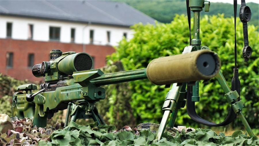 Sniper Rifle  Architecture Built Structure Close-up Day Field Fighting Focus On Foreground Green Color Land Military Nature No People Outdoors Plant Selective Focus Sniper Tree War Weapon