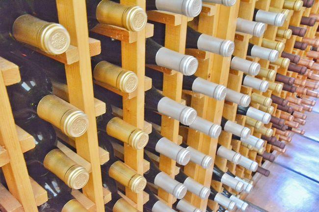 Wine bottles Abundance Arrangement Bottle Choice Close Up Close-up Full Frame In A Row Large Group Of Objects Order Selection Still Life Variation Wine Wine Bottles Wine Rack