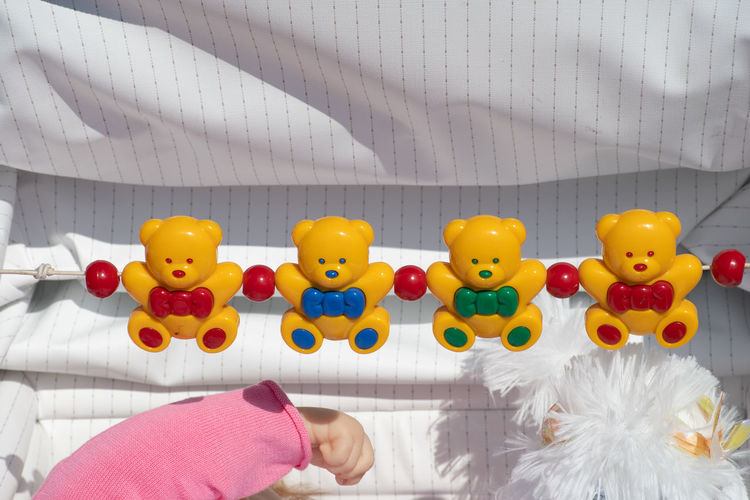 Small toy bears to distract baby in pram Baby Bear Teddy Body Part Childhood Childhood Memories Colorful Distractor Human Body Part Pram Toy Vintage Young Adult
