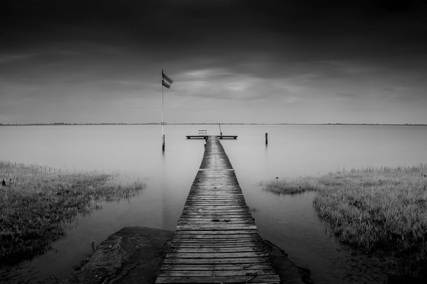 Water Direction Pier The Way Forward Sky Tranquility Wood - Material Nature Tranquil Scene Beauty In Nature Scenics - Nature Jetty Cloud - Sky No People Non-urban Scene Lake Day Diminishing Perspective Outdoors Wood Paneling Long