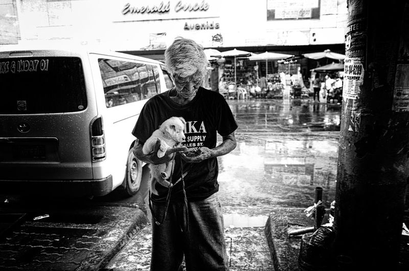 Dog Mobile Conversations Outdoors People Puppy Real People Senior Adult Senior Men Street Photography Texting Buddies The Street Photographer - 2017 EyeEm Awards