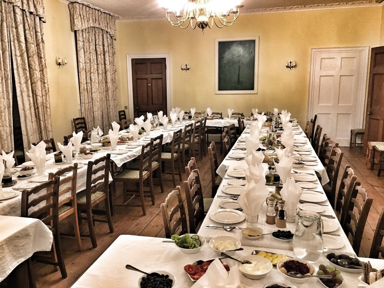 table, chair, place setting, tablecloth, dining table, empty, indoors, napkin, neat, restaurant, luxury, food and drink, elegance, seat, wineglass, no people, architecture, day