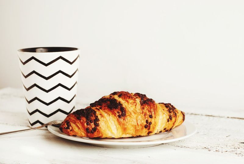 Coffe or tea cup with croissant over white rustic table. Copy space. Rustic Copy Space White Croissant Croissant Love Croissant Aux Chocolate Offe Coffee Drink Offee Cup Tea Tea Drink Tea Cup Breakfast ♥ Coffee Breake' White Background Studio Shot Baked Close-up Sweet Food Food And Drink Baked Pastry Item Pastry Dough Custard