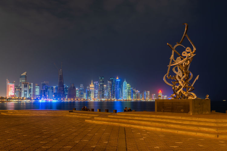 Doha, Qatar Architecture Built Structure Illuminated Night Building Exterior Sky City Building Tall - High Office Building Exterior Skyscraper Water Nature Tower No People Urban Skyline Travel Destinations Landscape Modern Cityscape Outdoors Travel Sculpture Doha Qatar Middle East