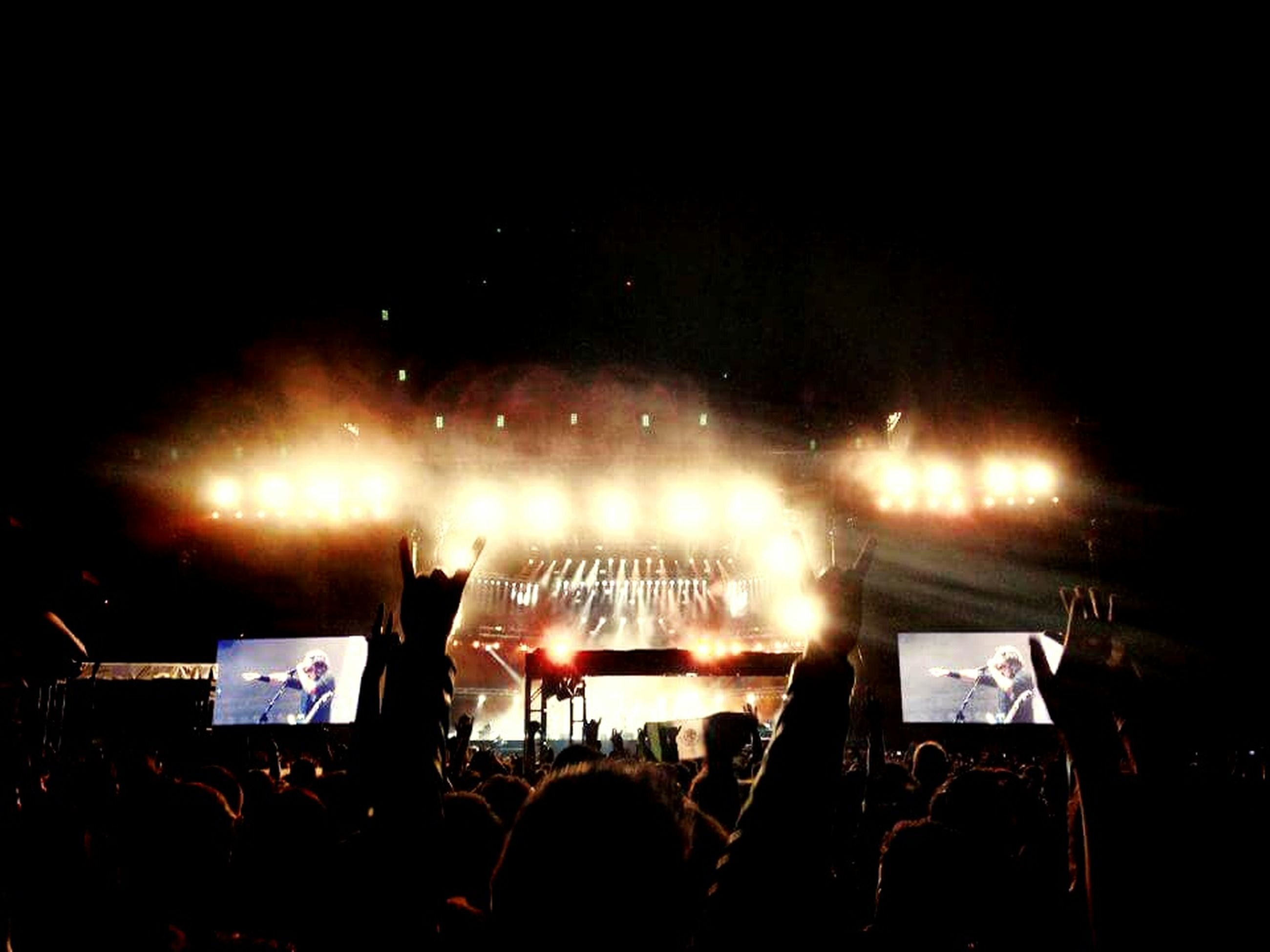large group of people, illuminated, night, men, crowd, lifestyles, arts culture and entertainment, person, music, leisure activity, event, nightlife, performance, stage - performance space, enjoyment, music festival, lighting equipment, popular music concert