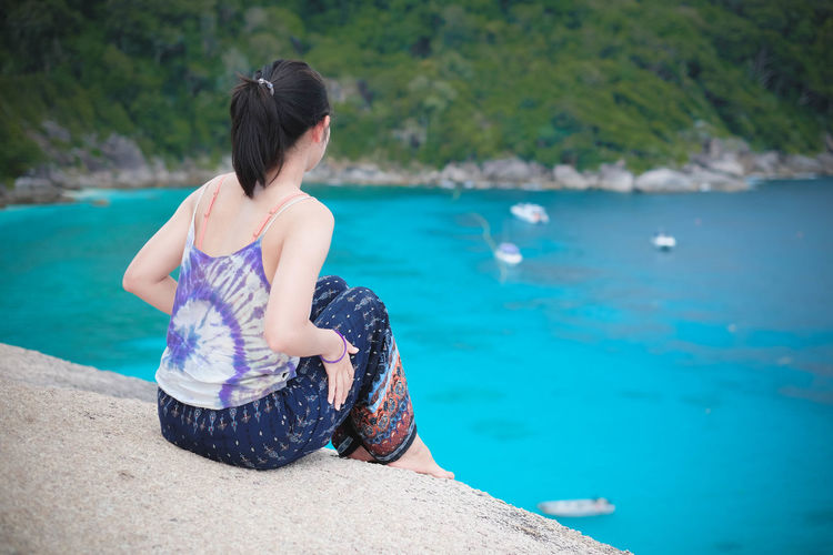 What is she think about ? Water One Person Sea Leisure Activity Lifestyles Real People Nature Beauty In Nature Day Women Land Holiday Vacations Sitting Trip Casual Clothing Scenics - Nature Focus On Foreground Outdoors Looking At View Turquoise Colored Andaman Sea Summer Thailand Similan Island, Thailand A New Beginning EyeEmNewHere