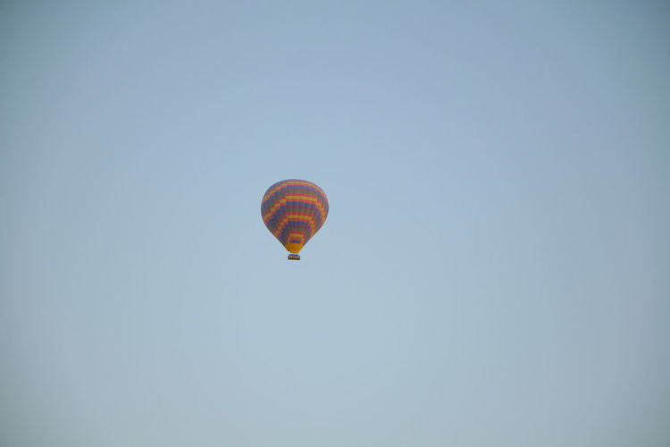 Low angle view of hot air balloon against clear sky