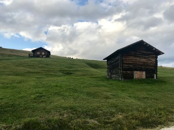 Wood Wood - Material Dolomites, Italy Built Structure Architecture Building Exterior Grass Cloud - Sky Building Land Sky Field Green Color House Landscape Environment Nature No People Rural Scene Agricultural Building