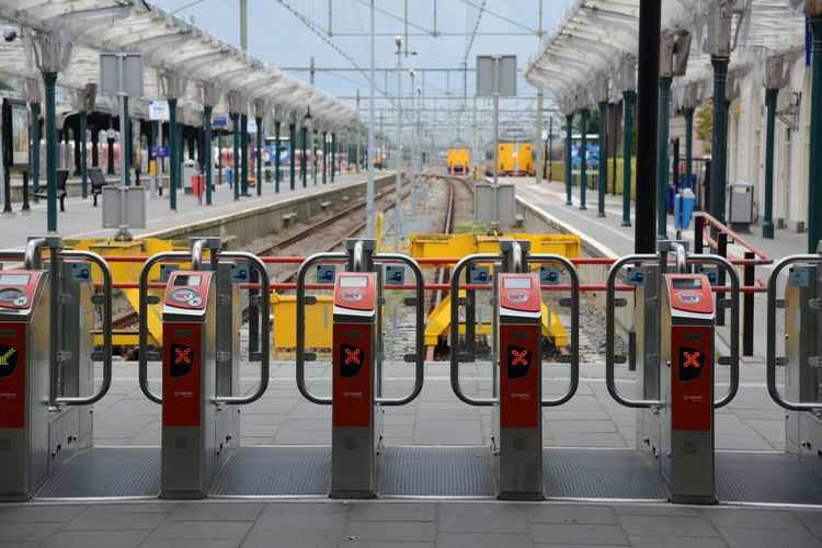 Architecture In A Row Transportation Mode Of Transportation Built Structure Security City Safety Technology Day Protection Railing Building Exterior Barricade Outdoors Connection Yellow Public Transportation No People Airport Tiled Floor