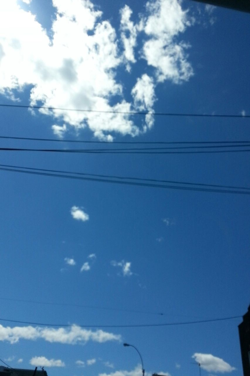 cable, sky, low angle view, cloud - sky, connection, power line, no people, blue, nature, day, outdoors, beauty in nature