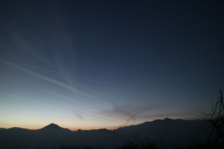 Cali night sky Jet Plane Beauty In Nature Blue Clouds Contrail Landscape Long Exposure Majestic Mountain Nature Night Night And Day No People Outdoors Scenics Silhouette Sky Star - Space Sunset Tranquil Scene Tranquility Vapor Trail