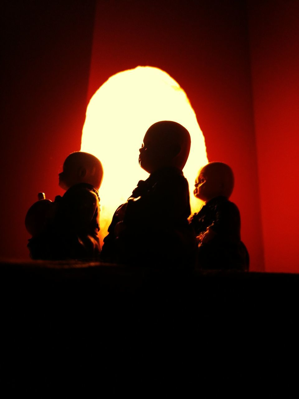 childhood, silhouette, orange color, real people, indoors, togetherness, sunset, love, boys, son, sitting, lifestyles, sky, day