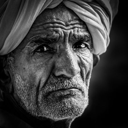 Each wrinkle on his face is correlated to some of those bitter and sweet experiences, who says once an individual dies he/she takes nothing with him/her. Experience can be the only thing that an individual can take after perishing. Wrinkles have many stories. Good has to happen after every bad phase in your life. #wrinkles #experience #monochrome #blackandwhite #black #white #contrast #dramatic #old #man #good #bad #happy #sad #portrait #portraitphotography #portraits #portraiture #fineart #fineartphotography #fineart_photobw