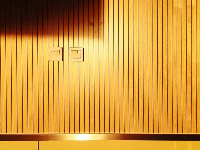 Sunlight falling on patterned wall