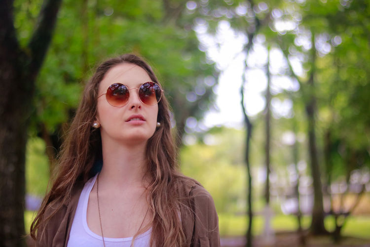 Adult Beautiful Woman Beauty Day Focus On Foreground Long Hair Nature One Person Outdoors People Portrait Sunglasses Tree Young Adult Young Women