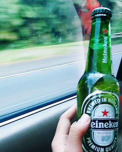Heineken Beer - Alcohol Drink Drank Drunk Swigg Cam ! Boozecruise Human Hand Car Human Body Part Transportation One Person Car Interior Holding Mode Of Transport Adults Only Outdoors People Day Only Men One Man Only Adult Close-up First Eyeem Photo