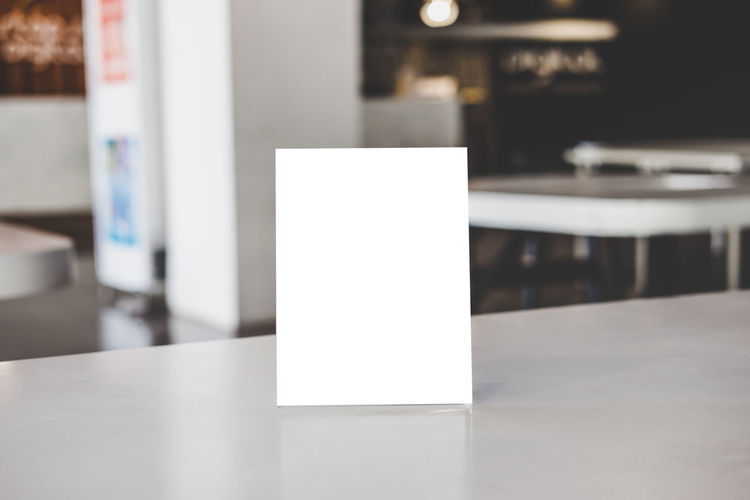Close-up of white paper on table