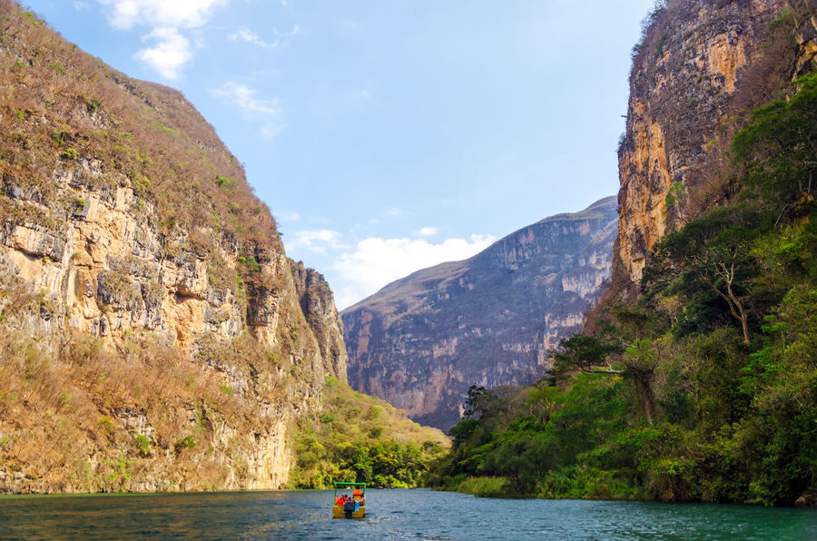 Looking up at the sky from deep within Sumidero Canyon in Mexico Adventure America Background Beautiful Canyon Color Green Gutierrez Holiday Landscape Light Mexico Mountain Mountains Nature Outdoor River Rock Sky Sumidero Sumidero Canyon Travel Tree Tuxtla Water